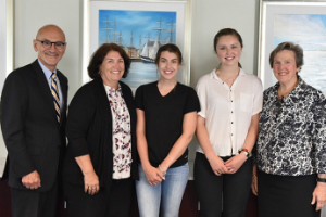 (L-R) David Storto, President of Partners Continuing Care and Spaulding Rehabilitation Network; Jean Bernhardt, Director, MGH Charlestown Health Care Center; scholarship recipients Kiley Doris & Emily Ringrose; Paula Milone-Nuzzo, President, MGH Institute