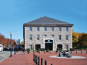 Photo of the shouse building in fall - it is made of grey bricks