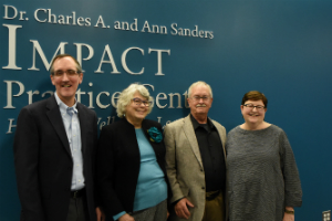 The Tabor-Connor family (l-r): Ken Tabor, Mary Duba, Jim Tabor, and Dr. Lisa Connor, in the first floor lobby of the IMPACT Practice Center.