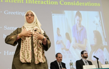 "Photo of  Dr. Heba Abolaban speaking on ""Caring for Muslim Patients"""