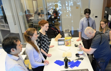 Photo of OTD students working with a client in the OT Center for Functional Living kitchen