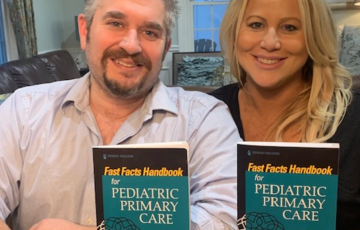 Mike and Kristine Ruggiero hold copies of their new textbook.