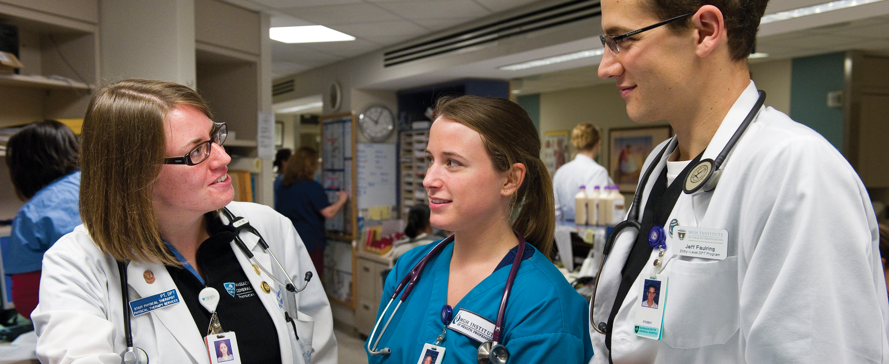 Photo of clincial preceptor working with a PT student and a nursing student