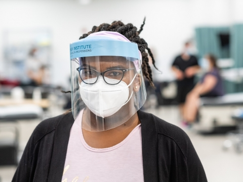 Image of a Black PA student wearing a facemask and shield