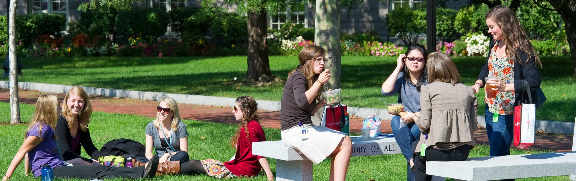 Campus lawn in summertime with students