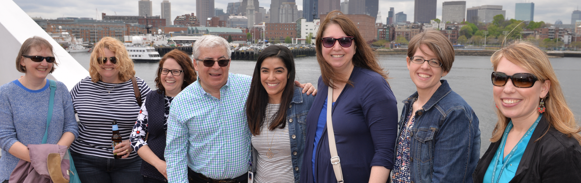 Faculty and staff celebrating on the 2016 Empoyee Appreciation cruise of Boston Harbor