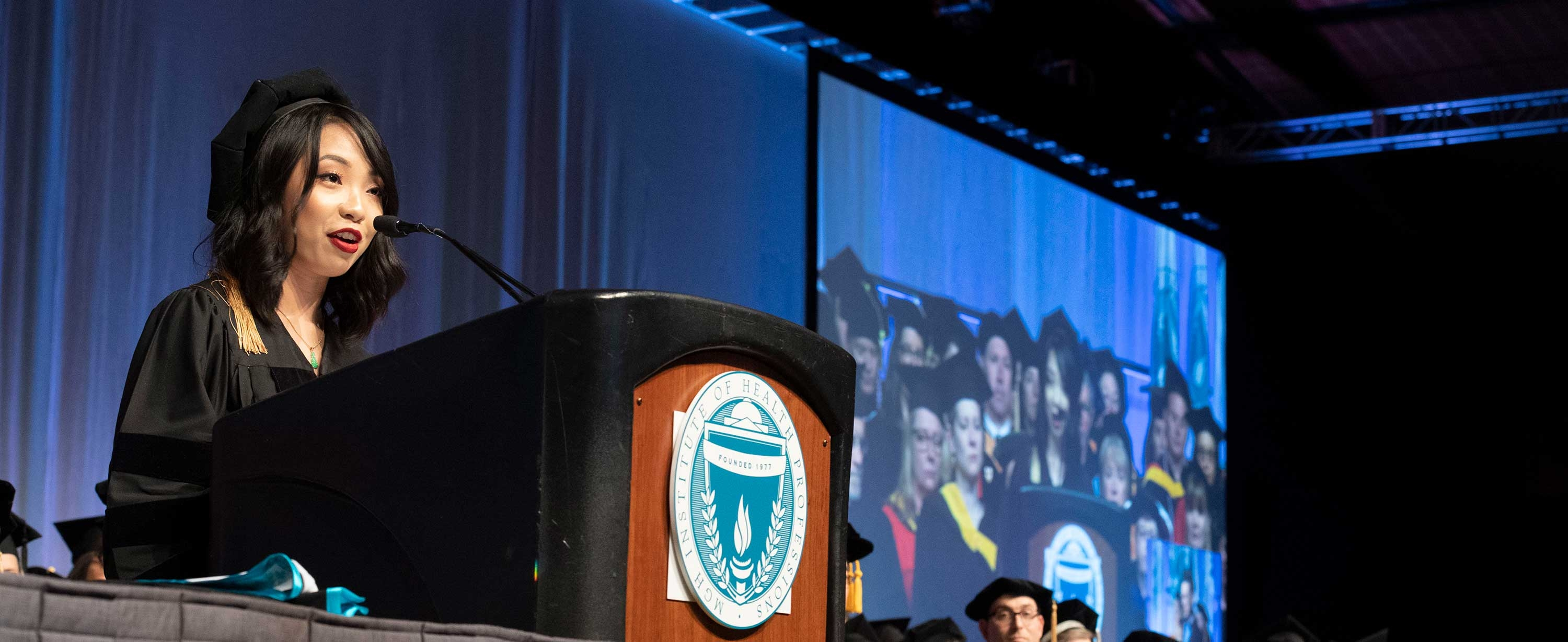 Photo of Baothy Huynh, OTD '19 speaking at 2019 Commencement