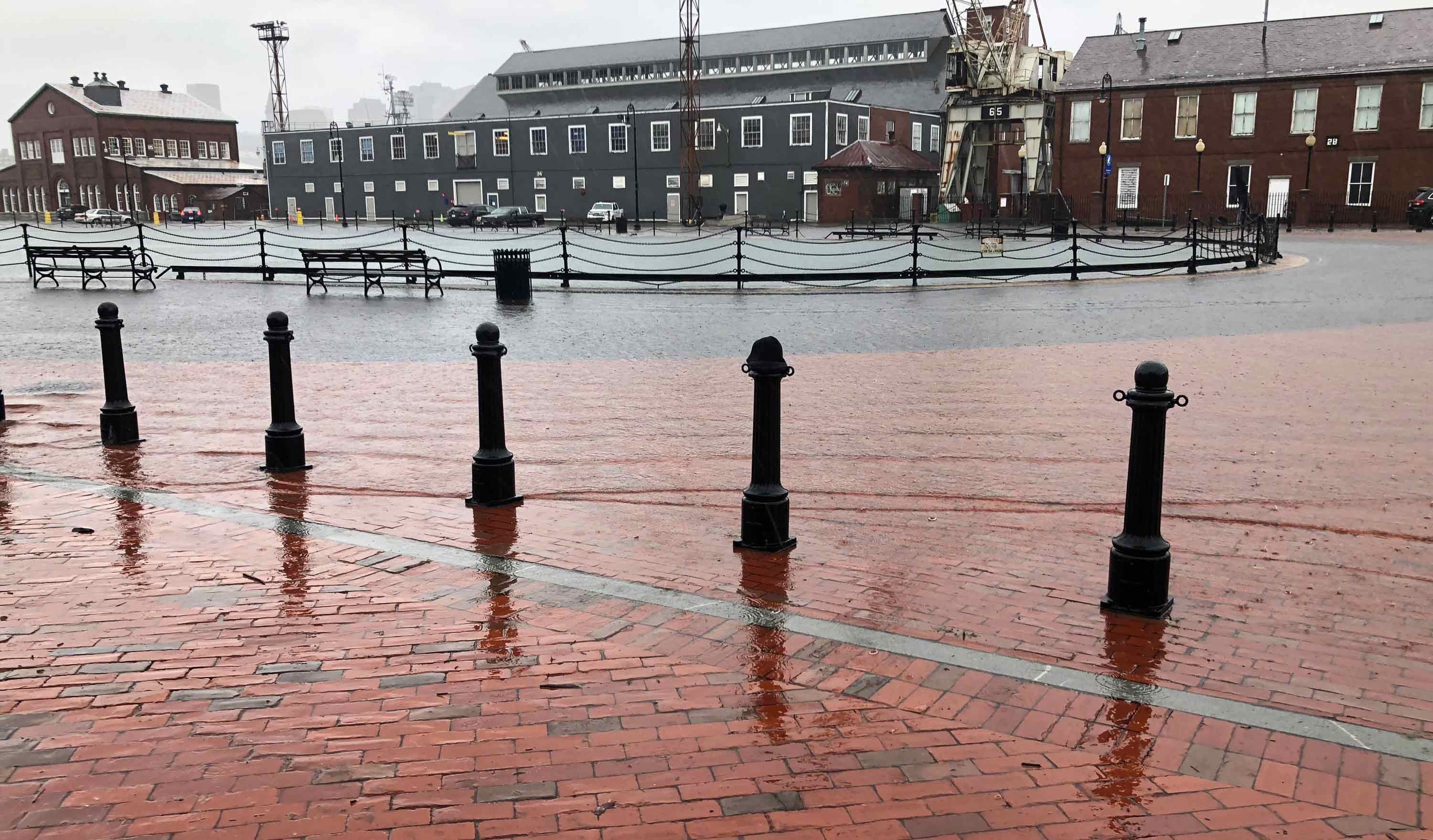 Photo of Boston Harbor flooding Charlestown Navy Yard