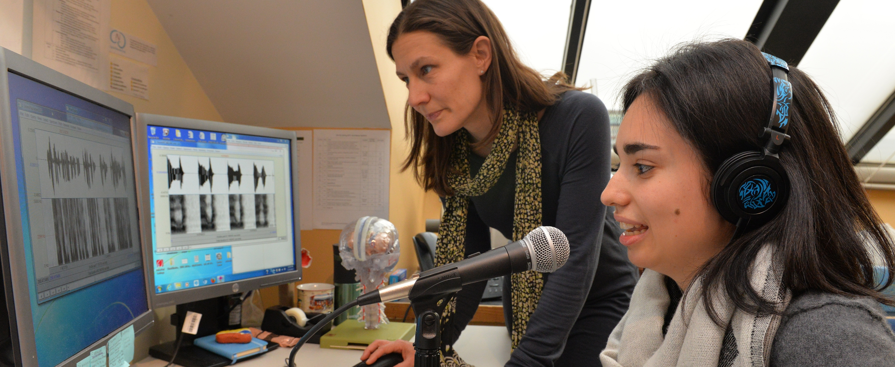 Dr. Zipse studying rhythm and timing abilities in people with Aphasia.
