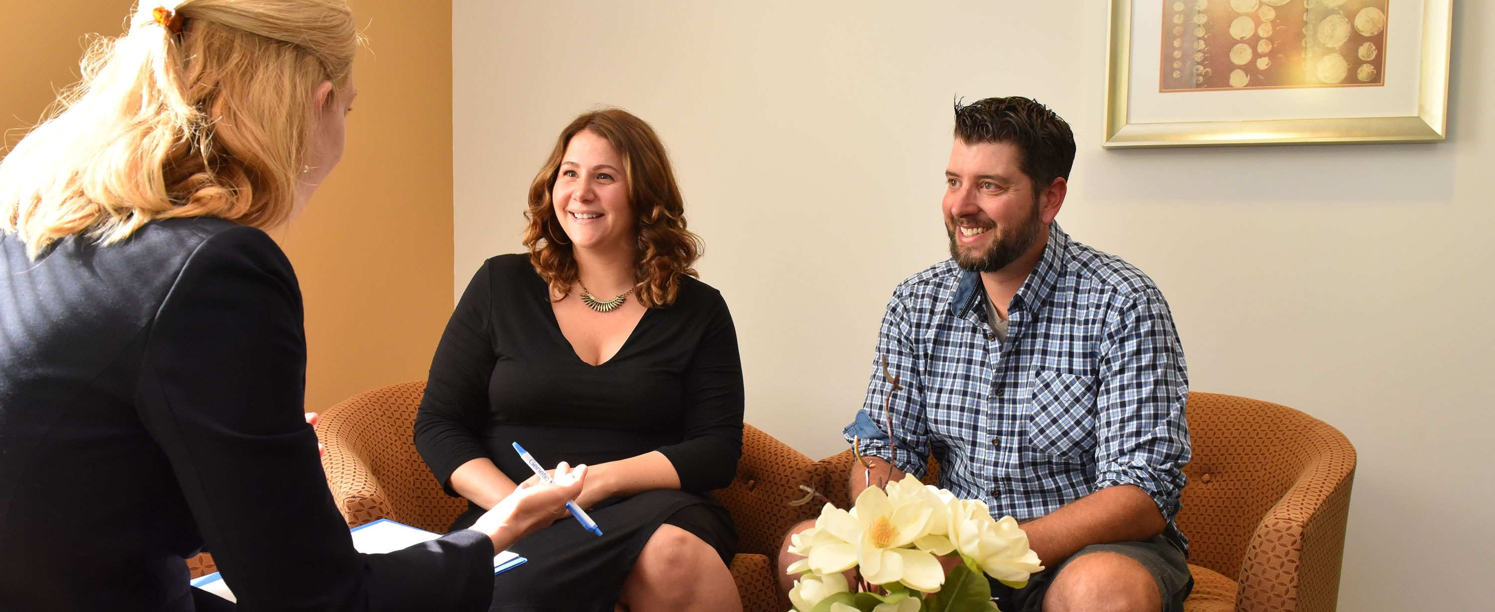 Genetic counselor with expectant couple