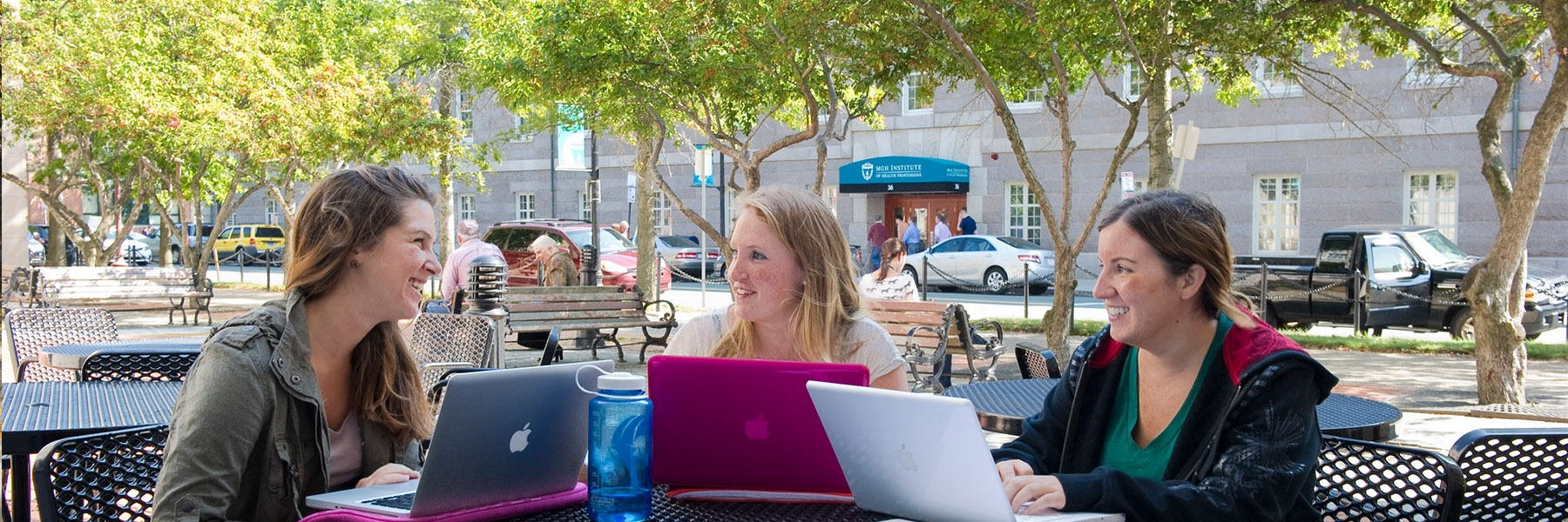 Group of female students studying outside