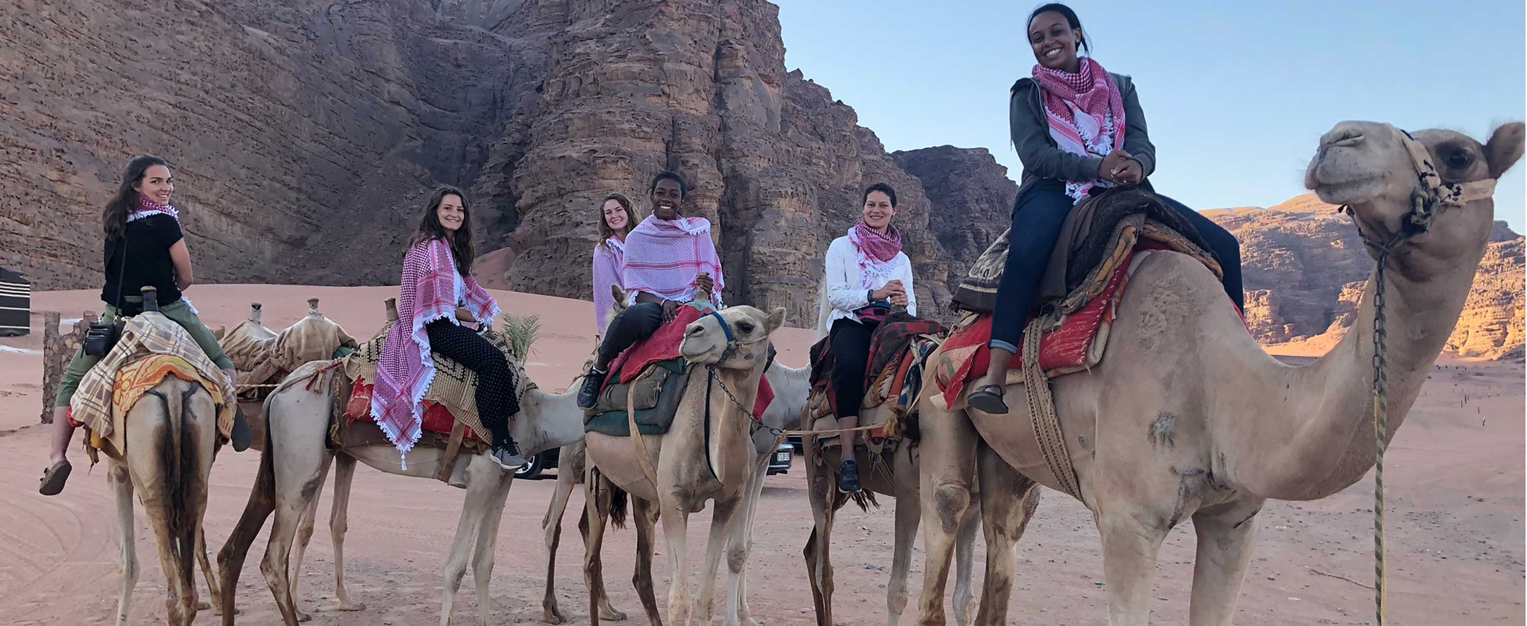 Photo of OT students riding camels in Jordan