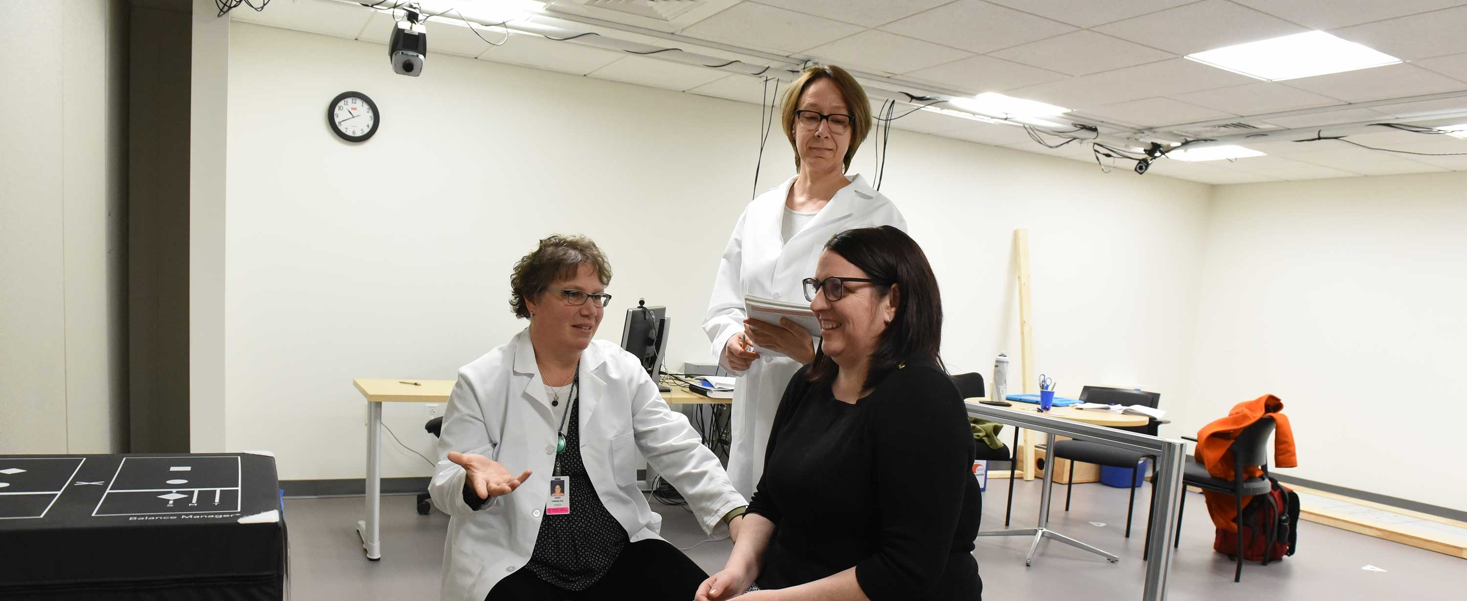 Photo of Drs. Lisa Wood and Janet Kneiss with research participant