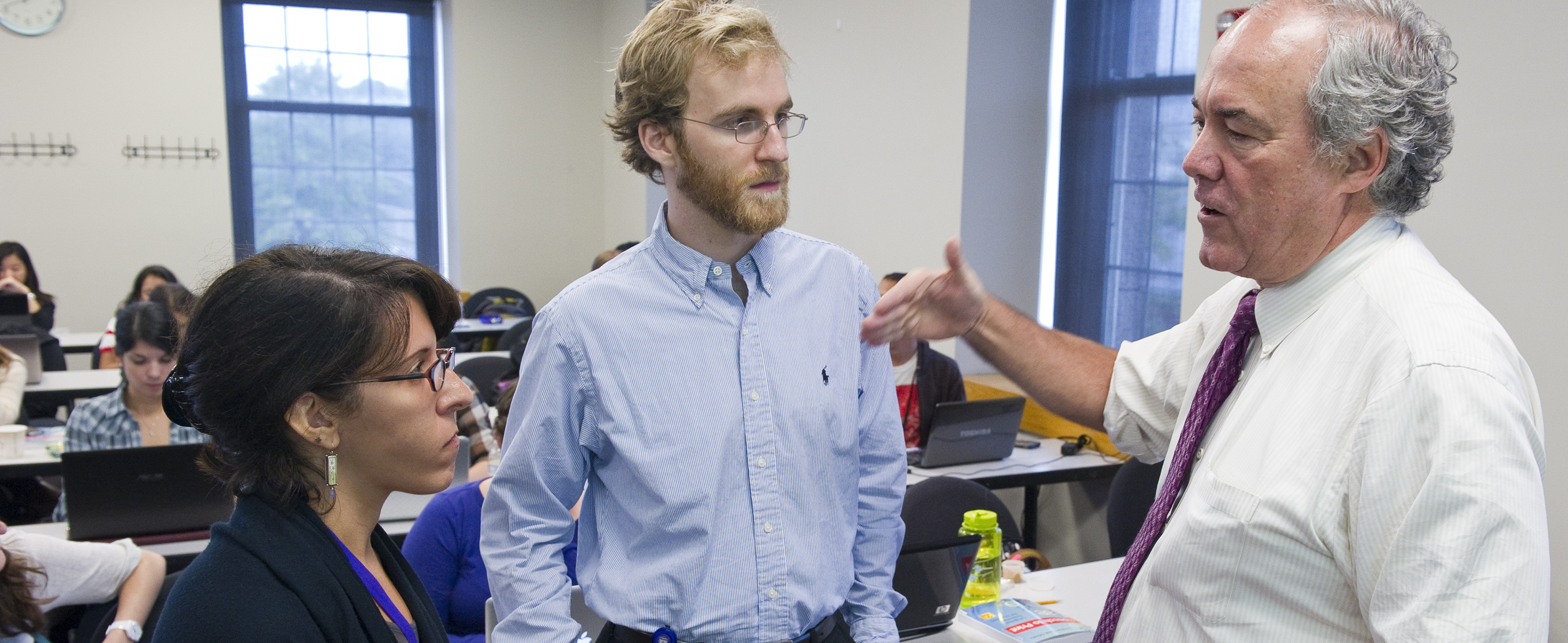 Dr. Charles Haynes talking with students