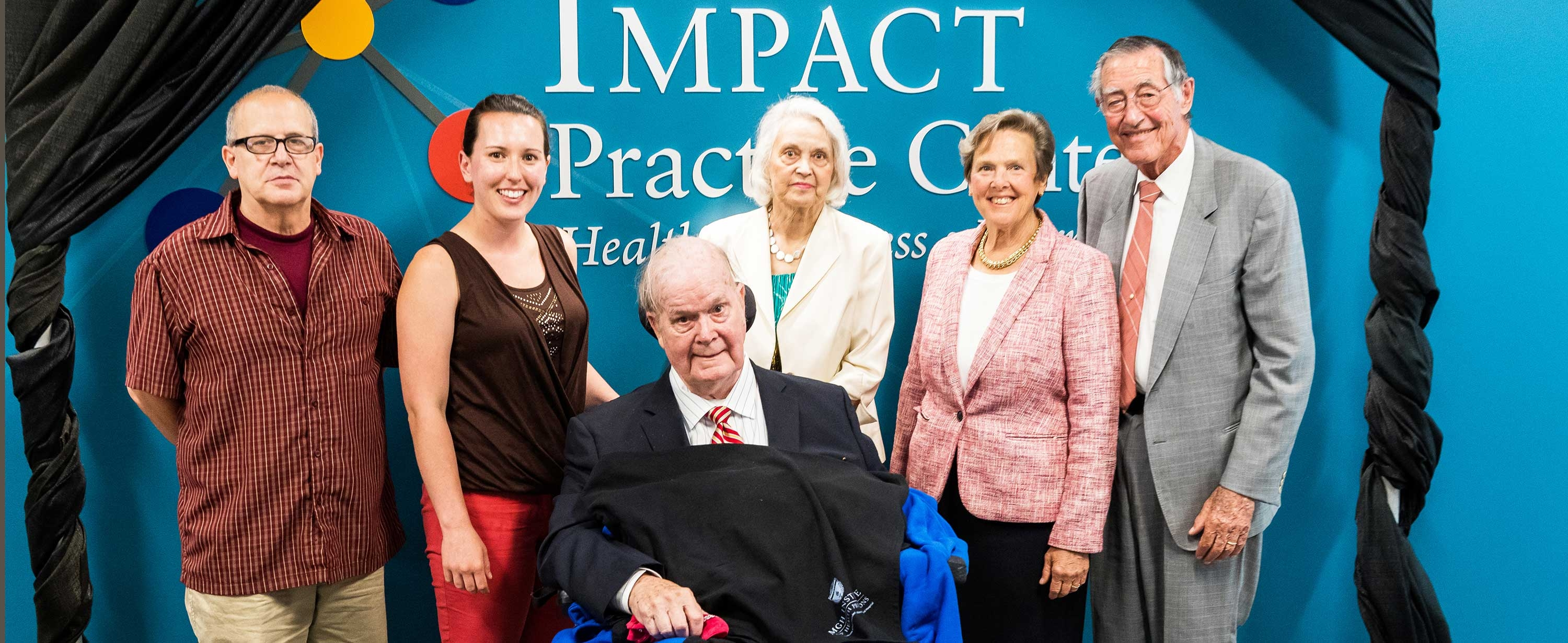 Photo of Dr. Charles A. and Ann Sanders with speakers at the IMPACT Center naming ceremony