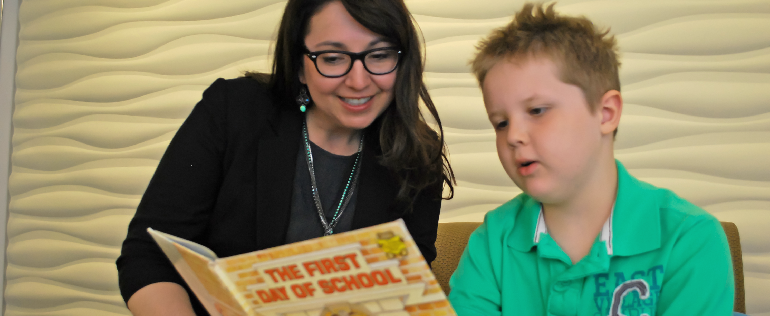 Dr. Tiffany Hogan working with reading client