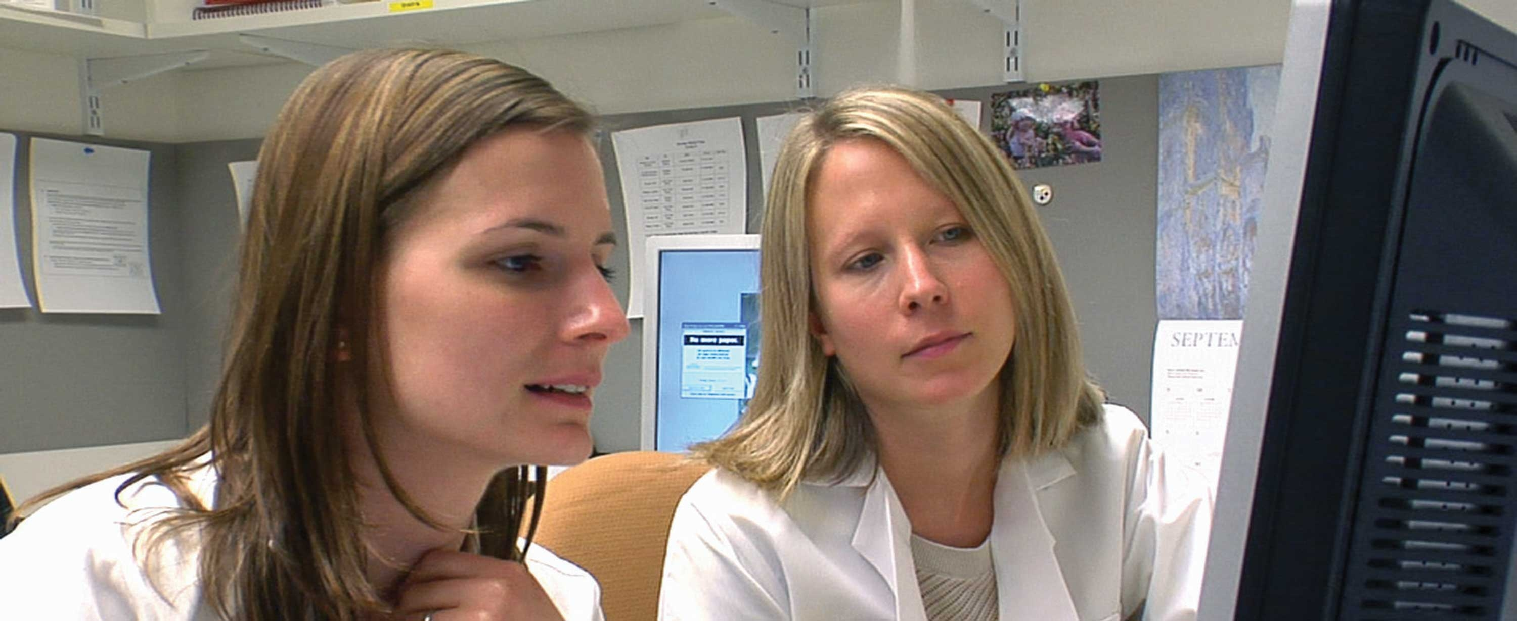 Two nurse practitioners conferring