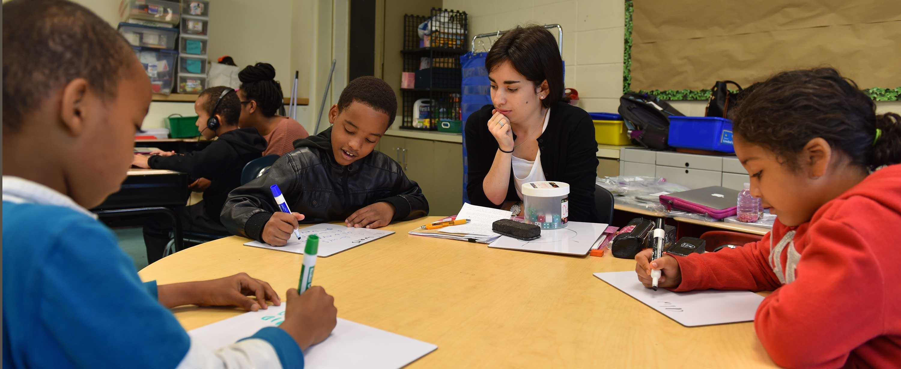 Image of students writing at Harvard-Kent School in Charlestown