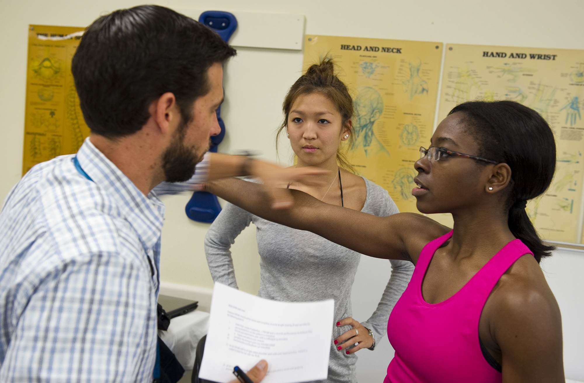 Photo of DPT faculty working with tudents in the PT labs.