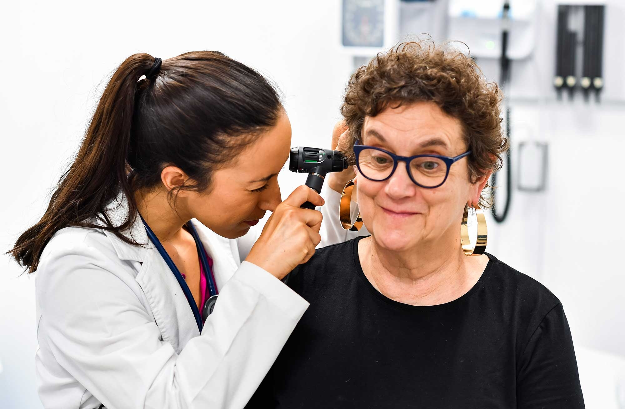 Image of NP student clinician examining a client at the Ruth Sleeper Nursing Center
