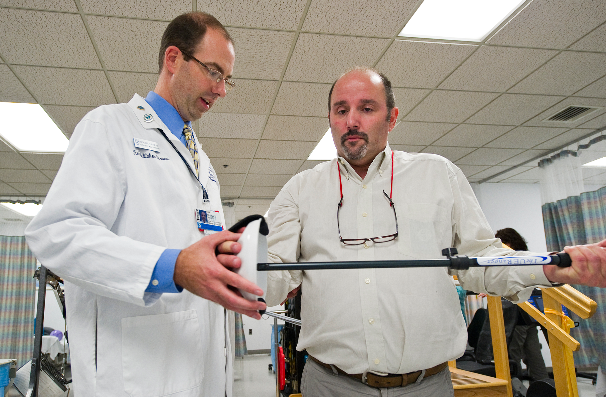 Photo of Clinical Residency in Orthopaedic Physical Therapy faculty member Reg Wilcox, DPT, MS, OCS working with patient