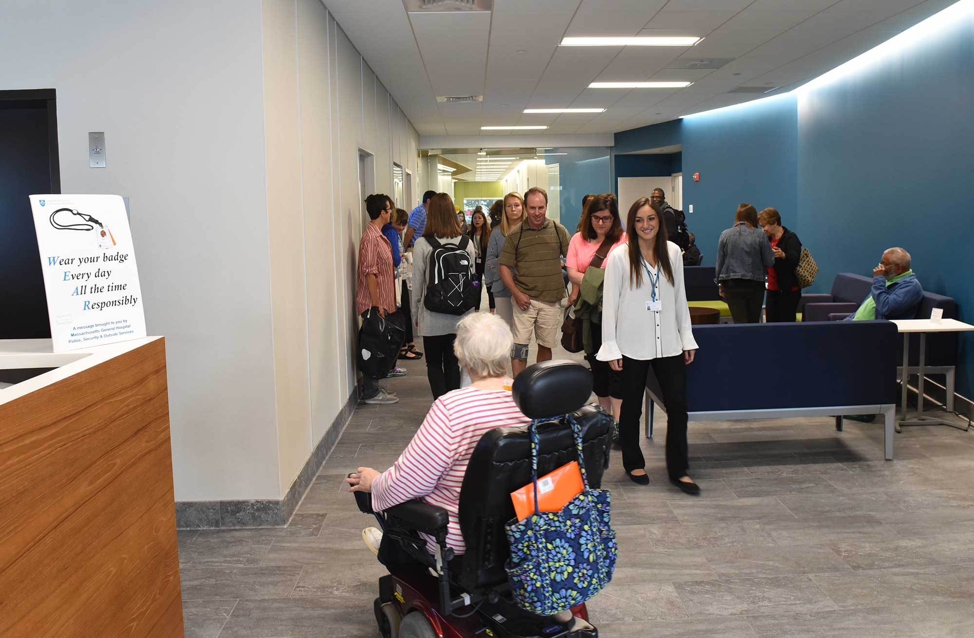 Photo of students in the IMPACT Center, one in wheelchair
