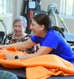 Gillian Piccoli, SLP '21, works with Zelma Lacey House resident Mary Delaney during Community Impact Day.