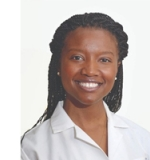 Profile photo of Kenya, she wears braids in her hair and a white collared shirt