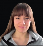 Profile photo of Nicole from the shoulders up, she has straight brown hair and bangs.