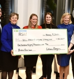 Photo shows group receiving large grant check