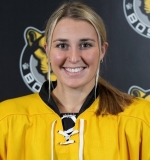Sammy Davis smiles for the camera in her hockey pads and jersey