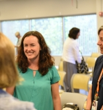 Laura Plummer talks to fellow faculty members at 2017 Convocation.