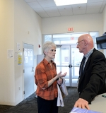 School of Nursing Instructor Donna White talking to Hope House Director Fred Newton