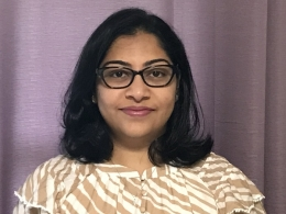 profile photo of Kinjal in front of a purple curtain