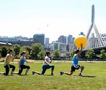 Photo of DPT students working out on lawn