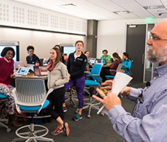 Photo of faculty teaching in the interactive classroom