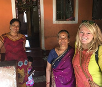 Photo of nurse practitioner student making home visit in local fishing village in India