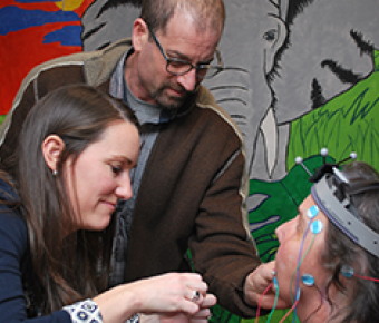 Photo of Research Director Jordan Green and PhD fellow examining a client in the Speech and Feeding Disorder Lab