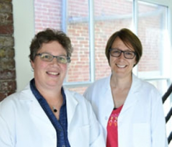 Image of researchers Dr. Janet Kneiss and Dr. Lisa Wood