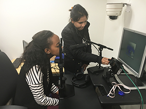 Undergraduate interns Ivy and Sijju use the Eye-tracking system