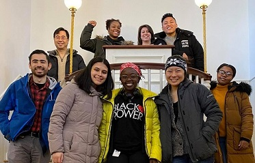 Group of multi-racial students on a staircase