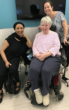 Photo shows two women who are part of the aphasia center