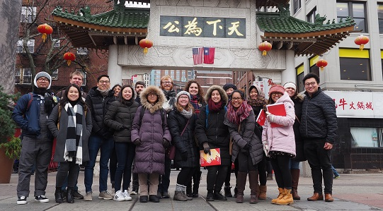 Multiethnic group in front of chinatown gate in boston
