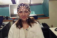 Young girl wearing EEG bubble