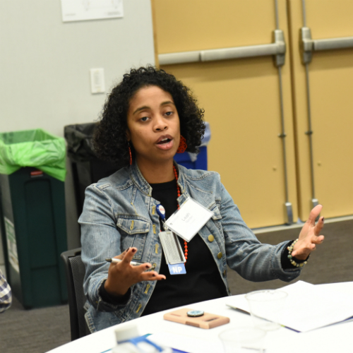 """Leah Gordon, assistant director of multicultural programming and inclusion, was one of 50 faculty and staff who led table discussions with new students at """"What is the IHP's Role in Health Care? Exploring the Impact of Power, Privilege, and Positionality"""" in June."""