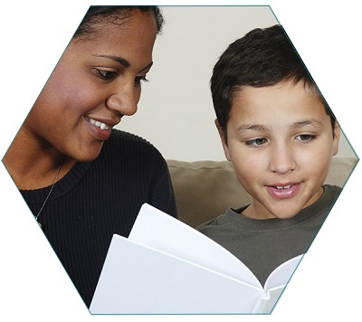 Multi-racial mom and son read to each other