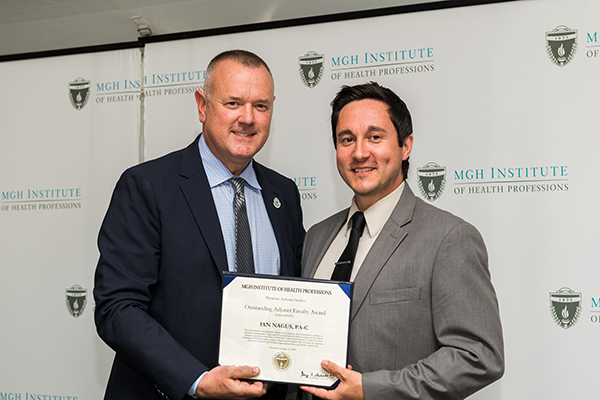 Photo of Ian Nagus (r) receiving the 2018 PA Outstanding Adjunct Faculty Award from Associate Program Director Christopher Sim