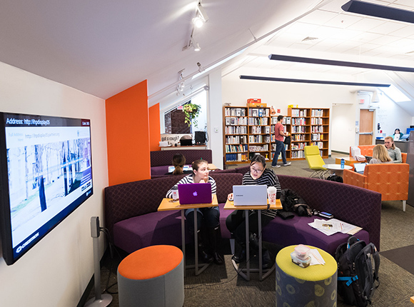 Image of students studying together in the library