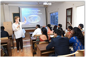 Photo of Elissa Ladd teaching in India