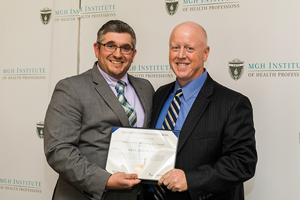 Photo of Dr. Paul Dwyer (r) receiving the 2018 PA Outstanding Clinical Faculty Award from  Instructor Michael Ruggiero